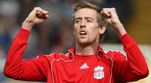 Former Liverpool striker Peter Crouch expects his old team to win the Premier League this season (Nick Potts/PA)