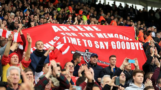 Some Arsenal fans hold a goodbye Arsene Wenger banner at their 1-0 win at West Brom on Saturday
