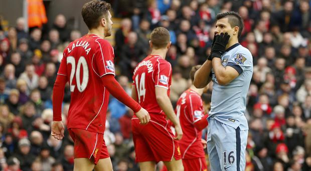 Sergio Aguero, right, and Manchester City have a miserable Anfield record (Lynne Cameron/PA)