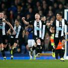Newcastle players celebrate drawing with Everton (Martin Rickett/PA)