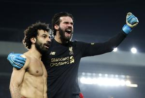"Liverpool goalkeeper Alisson, right, says Salah is ""hungry"" for goals (Martin Rickett/PA)"