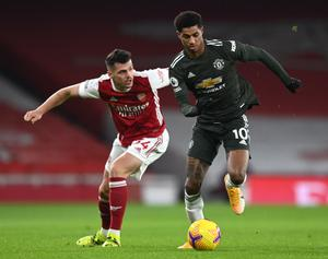 Marcus Rashford, right, was the target of online abuse after Manchester United's 0-0 draw at Arsenal on Saturday evening (Sean Botterill/PA)