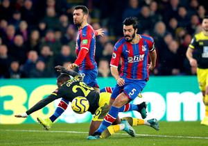 Crystal Palace defender James Tomkins, right, will be absent against Bournemouth (Nigel French/PA)