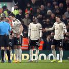 Referee Craig Pawson was surrounded by Manchester United's players (Martin Rickett/PA)