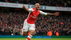 Theo Walcott netted in a thumping Arsenal win