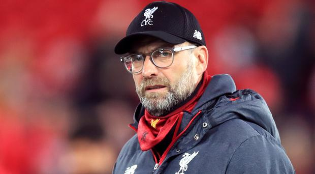 Liverpool manager Jurgen Klopp will have to do without Naby Keita against Everton (Peter Byrne/PA)