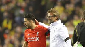 Liverpool's Emre Can (left) has been ruled out for four weeks with an ankle injury.