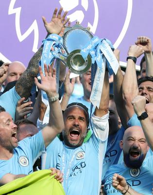 Guardiola's City clocked up a record 100 points in their 2017-18 title win (Martin Rickett/PA)
