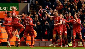 Pick it out: Jordan Henderson is mobbed after putting Liverpool ahead with a super strike against Burnley at Anfield