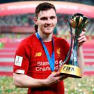 Top of the world: Andrew Robertson gets to grips with the Club World Cup