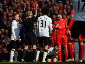 Red mist: Liverpool's Steven Gerrard is sent off by ref Martin Atkinson against Manchester United at Anfield yesterday