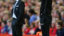 Eddie Howe manager of Bournemouth (right) gives instructions as Brendan Rodgers, manager of Liverpool looks on