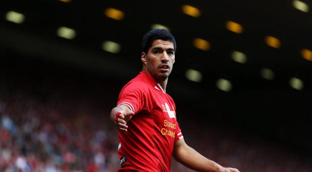 Liverpool striker Luis Suarez has claimed in quotes reported by The Guardian and the Daily Telegraph that he has an agreement in his contract allowing him to leave the club this summer