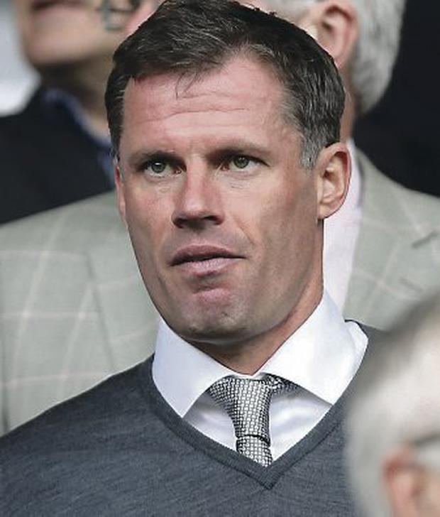 Liverpool former player Jamie Carragher in the stands during the Barclays Premier League match at Anfield, Liverpool