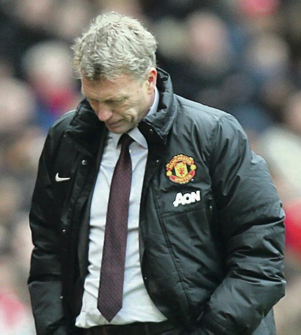 David Moyes watched his Manchester United team crash to a 3-0 defeat against Liverpool at Old Trafford