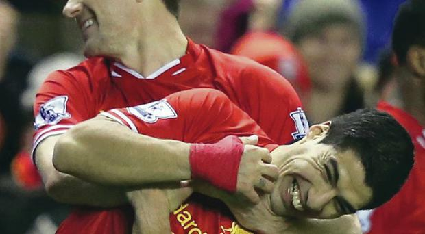 Unbridled joy: Steven Gerrard enjoys the moment with team-mate Luis Suarez after his goal against Sunderland last night