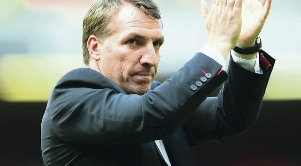 Taking the applause: The Liverpool faithful have warmed to Brendan Rodgers after a bright season yielded second place