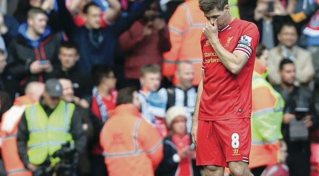 So close: Steven Gerrard shows his dejection at the final whistle at Anfield yesterday