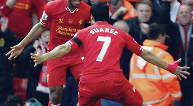 Doing it for Brendan: Liverpool stars Raheem Sterling and Luis Suarez enjoyed playing for Rodgers last season