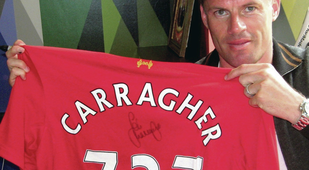 Pride in the shirt: Jamie Carragher, who played 737 games for Liverpool, is on his way to Belfast