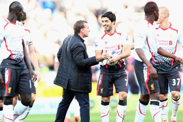 Happier times: Brendan Rodgers with Luis Suarez