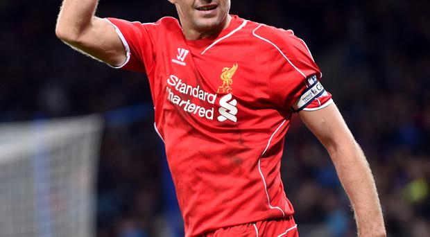 Captain crunch: Liverpool skipper Steven Gerrard is weighing up his options after being offered a new contract to stay at the club with manager Brendan Rodgers hoping that the midfielder signs on the dotted line