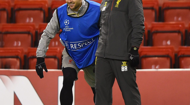 Brendan Rodgers smiles with Steven Gerrard during a training session ahead of the UEFA Champions League match against FC Basel at Anfield