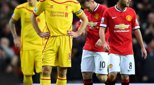 Tale of two cities: Liverpool's Steven Gerrard and Martin Skrtel look down as Man United's Wayne Rooney and Juan Mata celebrate