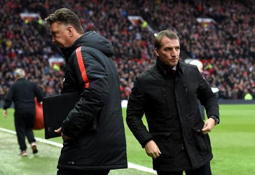 Painful defeat: Brendan Rodgers looks glum after a loss at Old Trafford to Man United