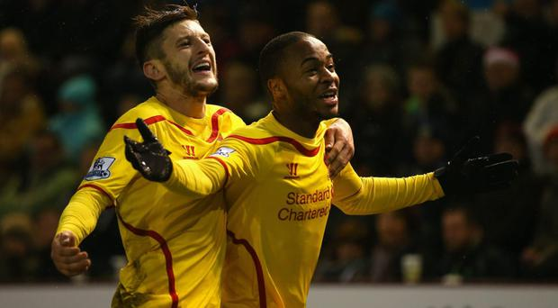 Touch of quality: Adam Lallana and Raheem Sterling hail the latter's winner against Burnley