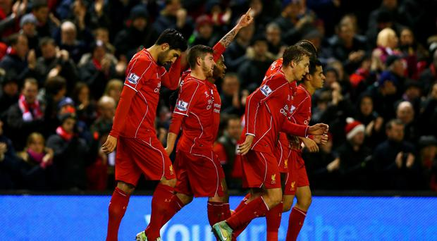 Red delight: Alberto Moreno (centre) takes the plaudits after opening the scoring against Swansea at Anfield