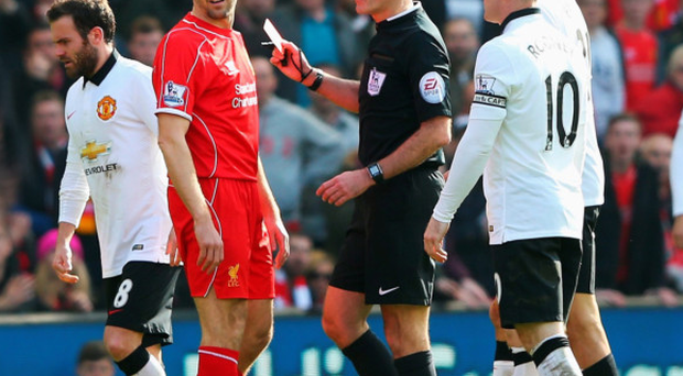 Red mist: Steven Gerrard's last game against United is one to forget