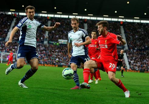 Battling: Adam Lallana challenges for the ball at West Brom