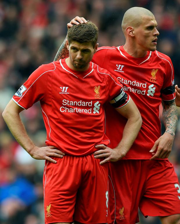 Consoling hand: Martin Skrtel with Steven Gerrard after miss