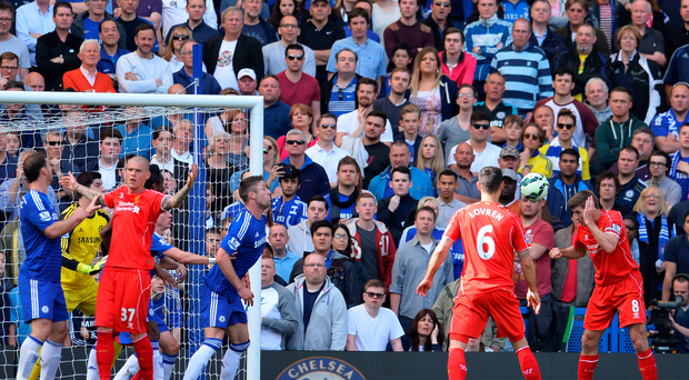 Using his head: Stephen Gerrard equalises for Liverpool at Stamford Bridge