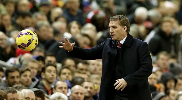 Brendan Rodgers will remain as Liverpool manager after a positive meeting with the club's owners