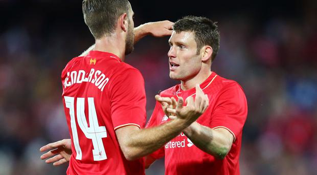 James Milner (R) of Liverpool celebrates with Jordan Henderson (L)