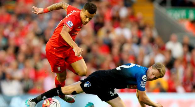 Liverpool's Philippe Coutinho battles for the ball with Bournemouth's Eunan O'Kane (right)