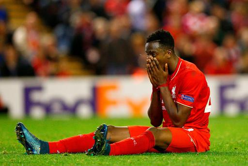 Drawing little comfort: Divock Origi sums up Liverpool's mood at Anfield