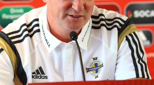 Support: Michael O'Neill has backed Brendan Rodgers