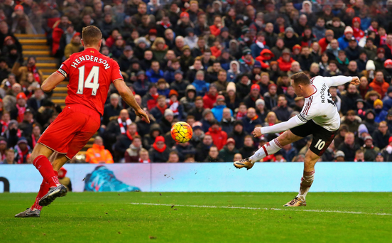 Sweet strike: Wayne Rooney scores Manchester United's winning goal against Liverpool.