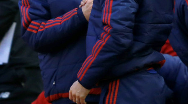 Relieved: Louis Van Gaal shakes hands with Ryan Giggs