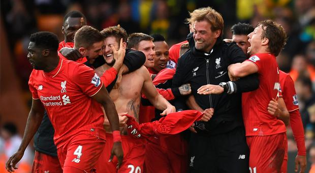 Smashing time: Jurgen Klopp broke his glasses as he joined in the celebrations after Liverpool's last-gasp winner