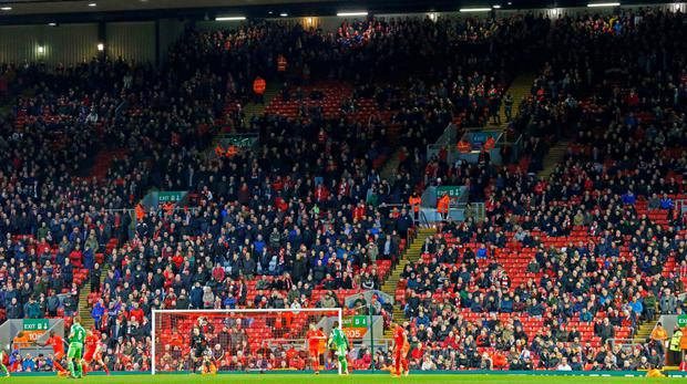 Powerful protest: around 10,000 empty seats were left at Anfield on Saturday after fans walked out over proposed plans to increase ticket prices