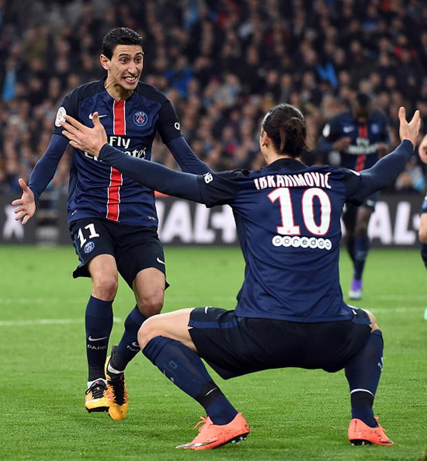 Easy street: Angel di Maria celebrates with Zlatan Ibrahimovic as PSG enjoy a whopping 24-point lead in Ligue 1