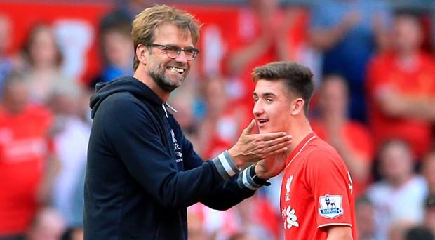 Red alert: Jurgen Klopp acknowledges Cameron Brannagan as he leaves the field after Liverpool's win over Watford