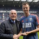 Well played: Jonny Evans collects the West Brom Players' Player of the Season