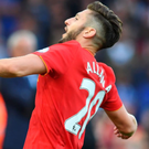 On target: Adam Lallana celebrates scoring Liverpool's third goal in their first home game of the season against Leicester