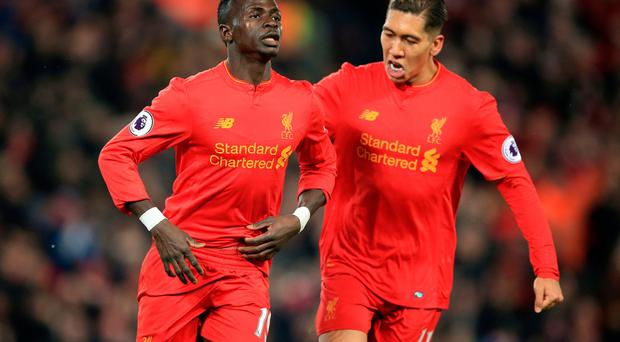 Bouncing back: Sadio Mane with team-mate Roberto Firmino