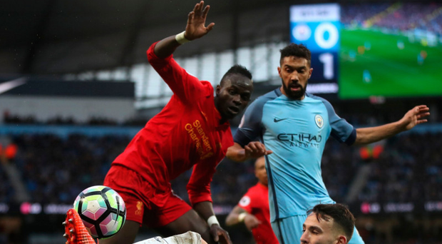 Crowded out: Manchester City's Gael Clichy and Nicolas Otamendi combine to thwart Sadio Mane